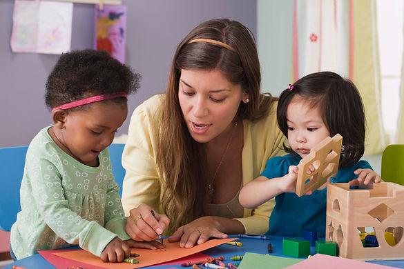 Teacher teaching young children