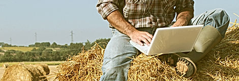 Image of a farmer working with automation. Depicts the work required to run a successful farm which leverages technology and know-how.