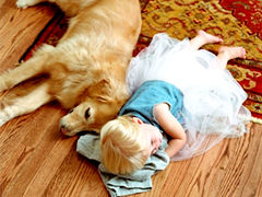 Girl sleeping on floor with dog