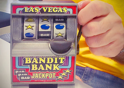 Toy slot machine being held by man