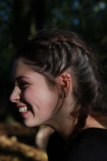 NYME earrings. Not Your Mother's Earrings. Butterflypin NYME earrings. Mimi Elisa fashion blogger smiling