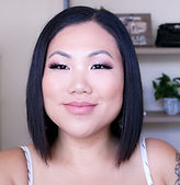 A close up photo of an asian female in her thirties.