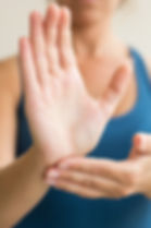 Woman's hands in classical Tai Chi pose.
