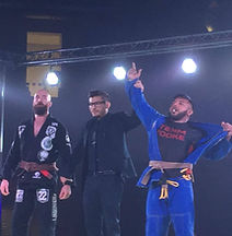 Edgar Escalante celebrating his arm bar victory at Fight to Win event