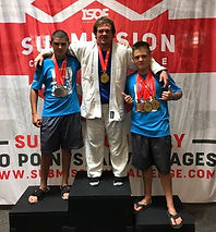 Keelan, T.mike, Kyler celebrating their victories at Submission Challenge OKC