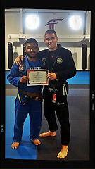 Edgar Escalante promoted to Brown Belt by Professor Travis Tooke