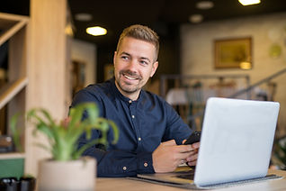 young-businessman-sitting-in-cozy-cafe-b