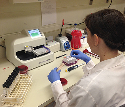 Mary testing the susceptibility of her organisms using the Sensititre system.