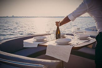 romantic lunch on motor yacht at sunset, Table setting at a luxury yacht._edited.jpg