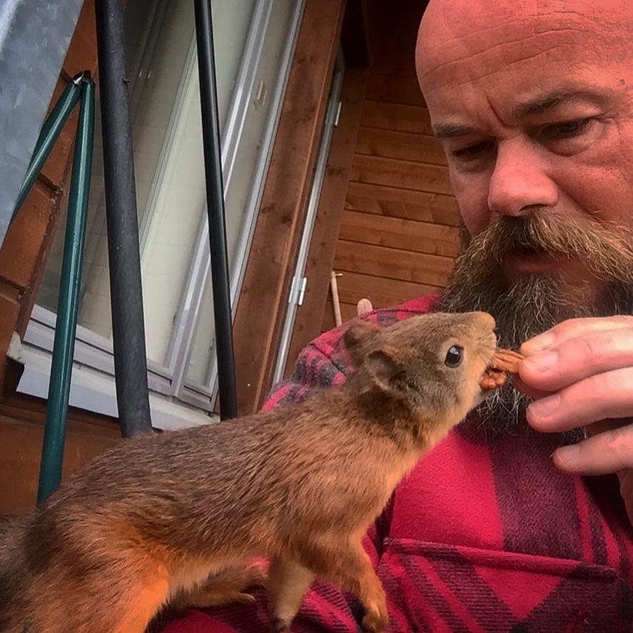 feeding a squirrel