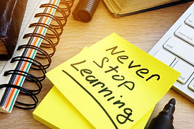 Never stop learning written on a memo st