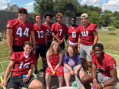 Local High School Football Players & Cheerleaders Surprise Special Birthday Girl