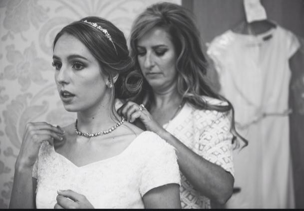 Mother of the Bride Putting Her Daughter's Necklace on