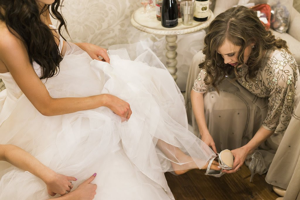 Mom Helping Bride with Shoes