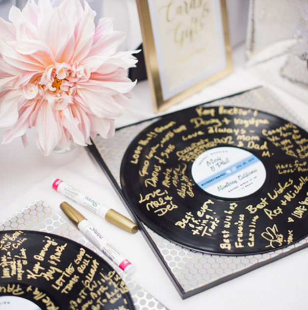 You can get a little creative and have your guests sign something other than a book!