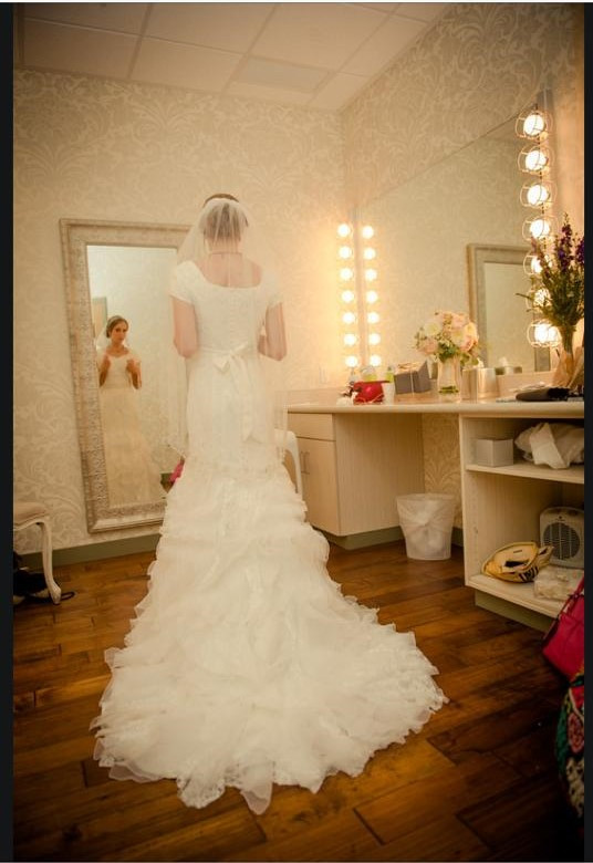 Bride Standing in front of the Mirror in the Bride's Room at the Vista Room in Cedar Hills