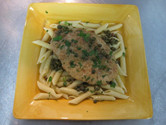 Veal Piccata on a bed of pasta.