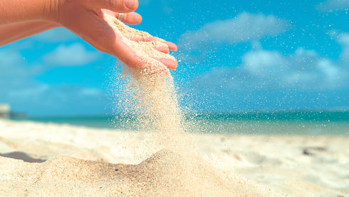 CLOSE UP_ Small grains of white sand sif