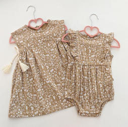 Golden Garden Jersey Side Gather Tassel Dress