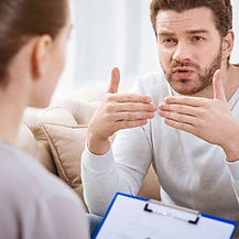 Image of man speaking with a provider