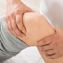 Closeup of Physical Therapist working on patient's knee
