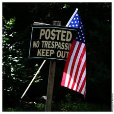 No Tresspassing Sign with Americam Flag