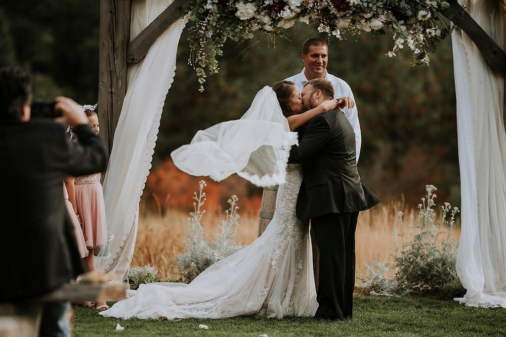 first kiss, outdoor wedding, wedding photographer, destination wedding photographer, Rosendahl Photography, pnw wedding photographer, ceremony, bride and groom