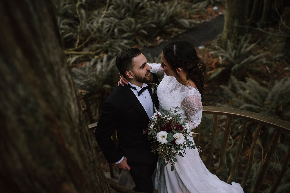 Pacific Northwest forest wedding bride and groom on the primitive wooden staircase