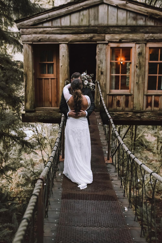 Treehouse Wedding bride and groom on the suspension bridge.