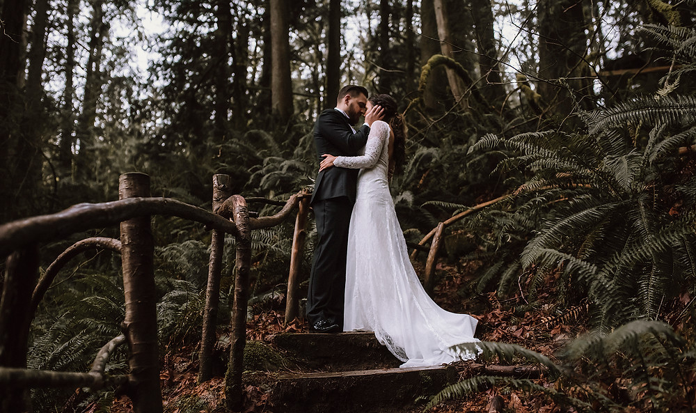 Pacific Northwest forest wedding photo bride and groom in a forest of sword ferns