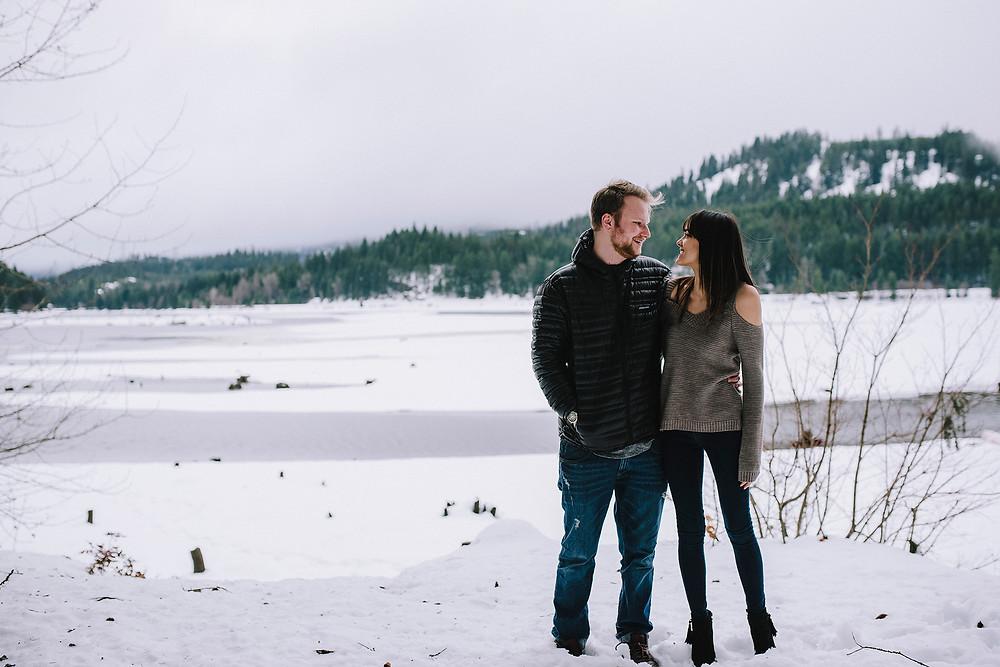Engagement photos, couple near frozen lake