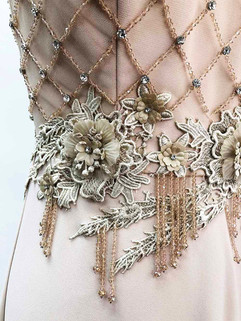 Hand beading, lace applique, and beading fringe detail.