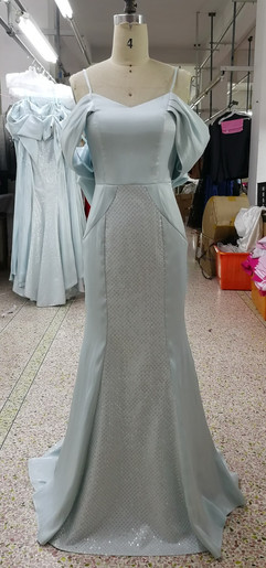Evening dress with dropped sleeves