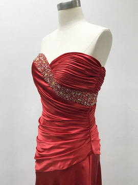 Hand-pleated evening dress with beading