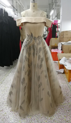 Evening gown with pleating and applique