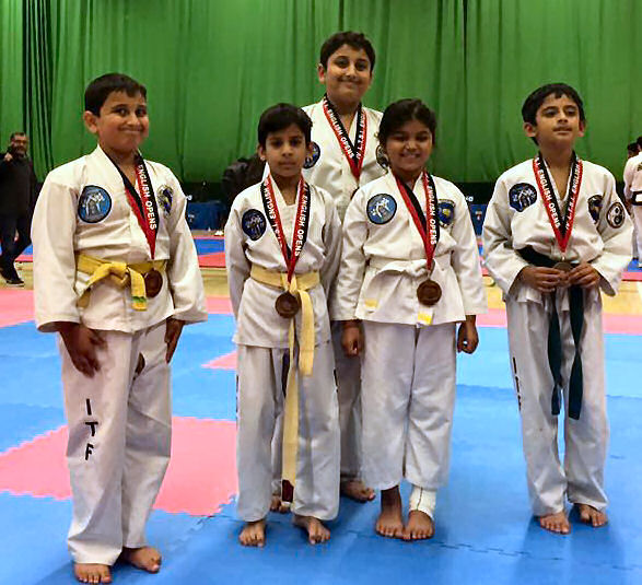 Young students of the Academy after winning Bronze in Team Patterns