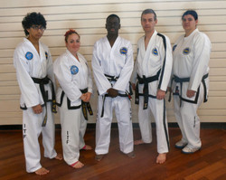 Mr Odunaiya receiving his black belt