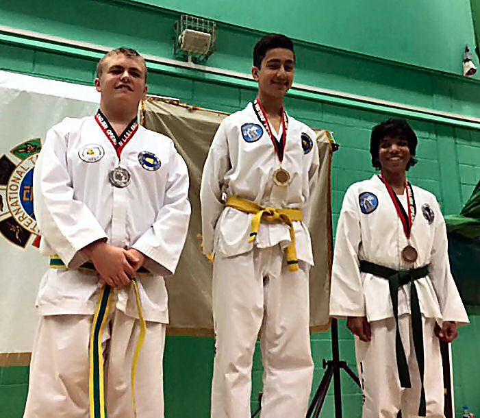 Academy students Saeed Yusufi and Chetan Patel in gold and bronze positions for Sparring