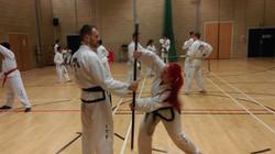 Students practice pole defences