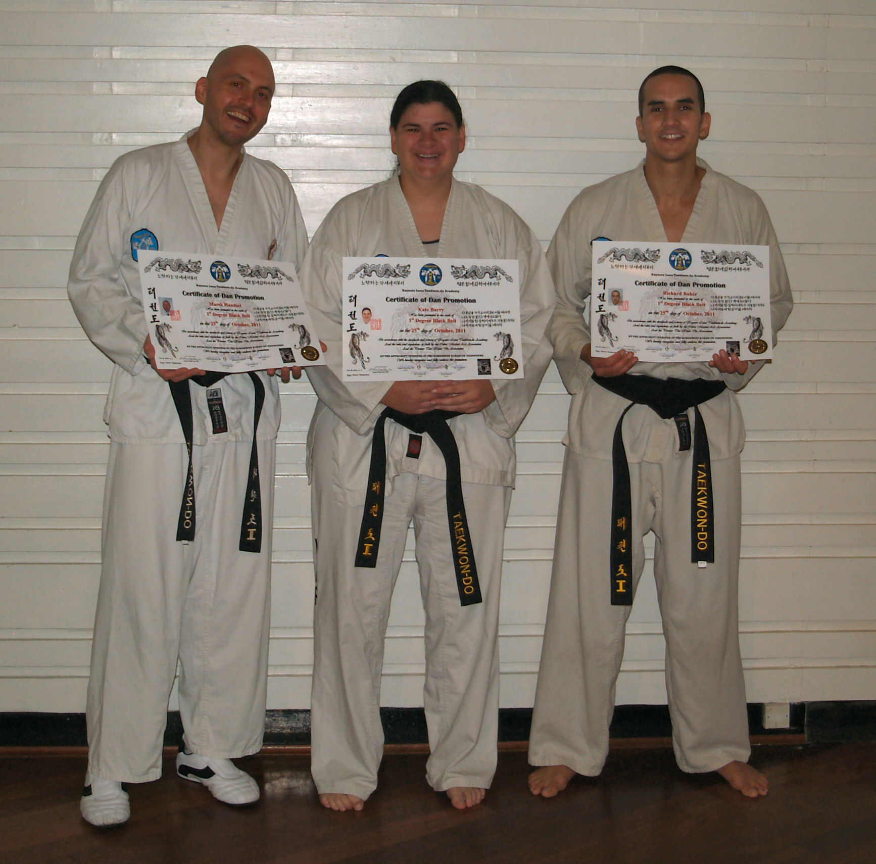 Black Belts with their certificates