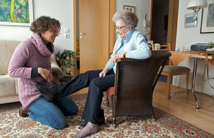 caregiver tieing shoes.jpg