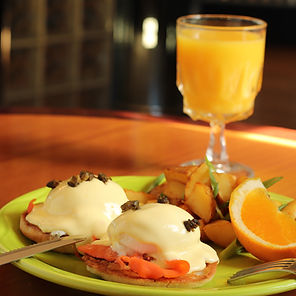 Salmon Lox Eggs Benedict with orange juice.