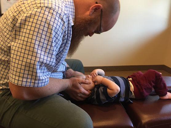 Dr. Maltby adjusting is son.