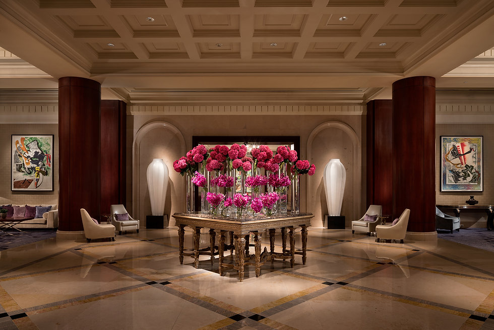 The Ritz-Carlton Dallas lobby with pink hydrangea an mums displayed n a table.