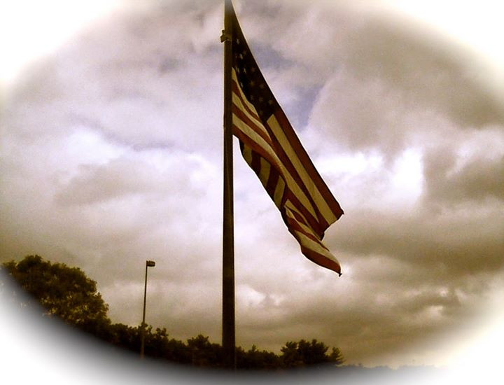 Facebook - While sitting in my car, I happened to look up and saw our flag wavin