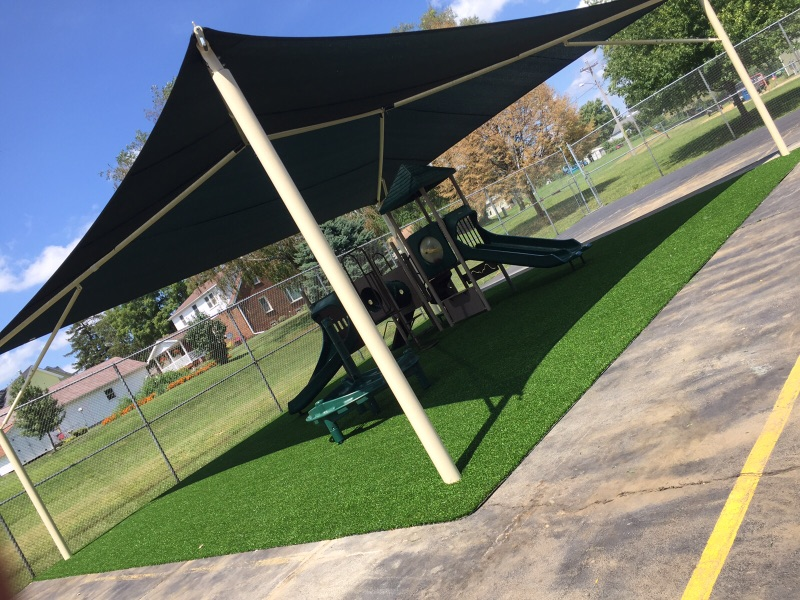 Playground with Playground Grass installed and canopy.