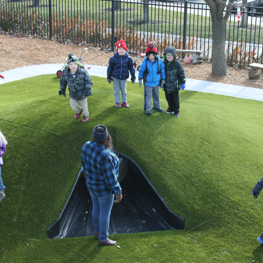 Custom berm with tunnel, 3 to 5 year old playground.