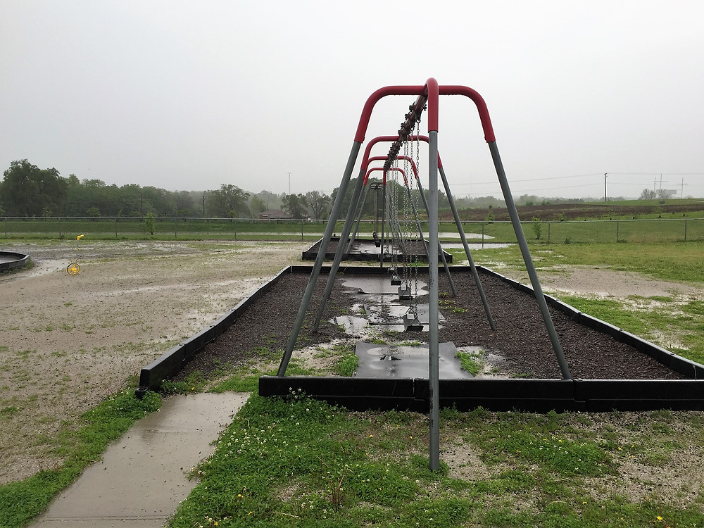 Muddy ground around playground swings