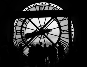Paris - Clock Watching - The view through the clock in the Musee D'Orsay, Paris. Sacre Coeur and Montmartre can be glimpsed in the distance