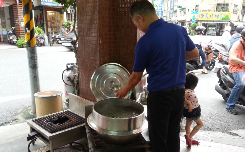 Man serving himself a soup
